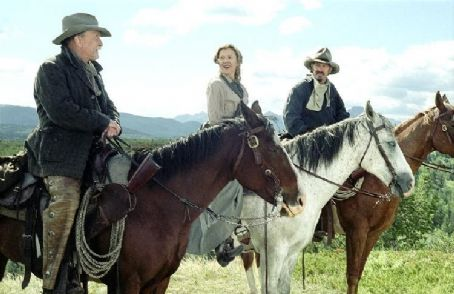 Open Range Boss (Robert Duvall, left), Sue (Annette Bening, center), and Charley (Kevin Costner, right) saddle up.