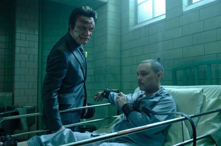Doug Hutchison Jigsaw (Dominic West) and his brother Loony Bin Jim () in PUNISHER: WAR ZONE. Photo credit: Jonathan Wenk