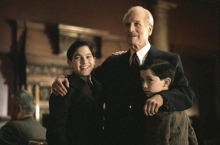 Tyler Hoechlin Mr. Rooney (Paul Newman) gives a warm greeting to the Sullivan family, including the two young sons, Michael, Jr. (, left) and Peter (Liam Aiken) in DreamWorks Pictures' and Twentieth Century Fox's Road To Perdition - 2002
