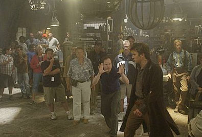 Nathan Fillion Joss Whedon (Director) and  (Captain Mal Reynolds) on set.