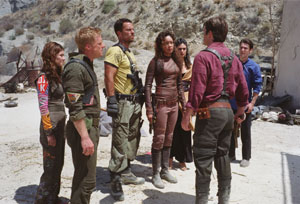 Nathan Fillion Gina Torres as Zoë Warren in Joss Whedon's action Serenity also starring  and Alan Tudyk - 2005