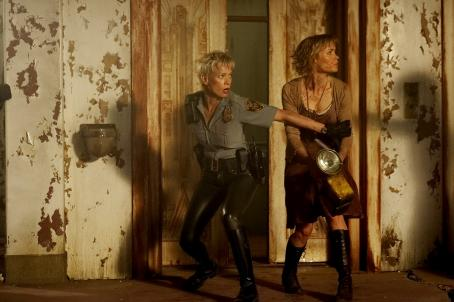 Laurie Holden  as Cybil Bennet and Radha Mitchell as Rose in horror movie Silent Hill - 2006. Distributed by Sony Pictures.