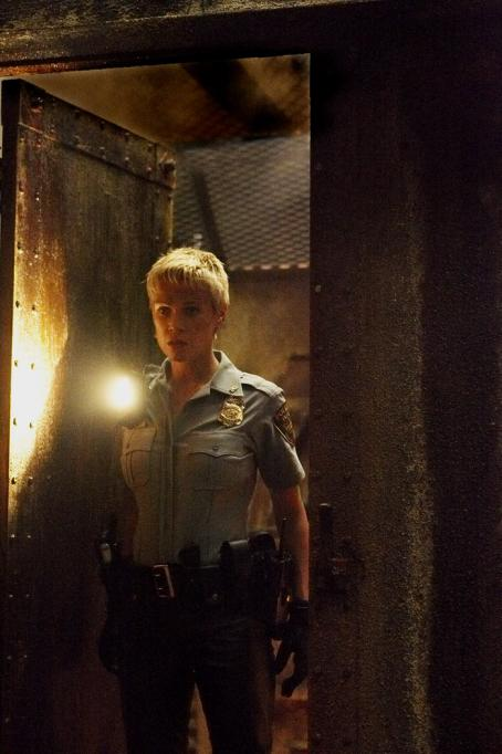 Laurie Holden  as Cybil Bennet searches Sharon in Sony Pictures' Silent Hill - 2006.