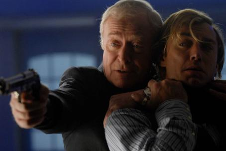 Sleuth Left: Michael Caine as Andrew Wyke; Right: Jude Law as Milo Tindle. Photo by David Appleby © 2007  Productions LTD, courtesy Sony Pictures Classics. All Rights Reserved.