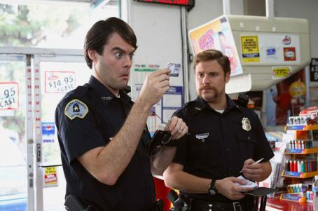 Bill Hader Two clueless cops, Officer Slater (, left) and Officer Michaels (Seth Rogen, right) check out the identification of McLovin, the 25-yearold Hawaiian organ donor, in Superbad, the new film from producers Judd Apatow and Shauna Robertson (The 40-Y