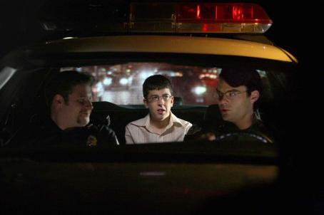 Bill Hader Fogell (Christopher Mintz-Plasse, center) – posing as McLovin, the 25-year-old Hawaiian organ donor – is taken for the adventure of his young life so far by two clueless cops, Officer Michaels (Seth Rogen, left) and Officer Slater (,