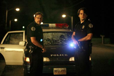 Bill Hader Two clueless cops, Officer Michaels (Seth Rogen, left) and Officer Slater (, right) make life interesting for three young guys having the night of their lives in Superbad, the new film from producers Judd Apatow and Shauna Robertson (The 40-Year