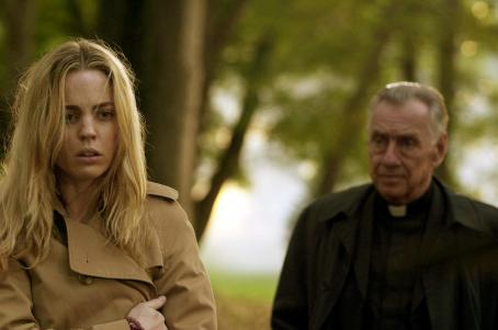 Philip Baker Hall Melissa George as Kathy Lutz and  as Father McNamara.