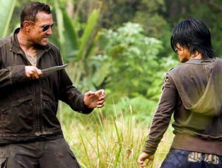 Rick Hoffman  as Goldman and Masa Yamaguchi as Saiga in The Condemned - 2007