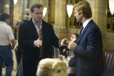 "Christopher Nolan Director CHRISTOPHER NOLAN and AARON ECKHART on the set of Warner Bros. Pictures' and Legendary Pictures' action drama ""The Dark Knight,"" distributed by Warner Bros. Pictures and also starring Christian Bale, Michael Caine, Heath L"