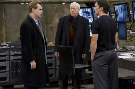 "Christopher Nolan Director CHRISTOPHER NOLAN on the set with MICHAEL CAINE and CHRISTIAN BALE for Warner Bros. Pictures' and Legendary Pictures' action drama ""The Dark Knight,"" distributed by Warner Bros. Pictures and also starring Heath Ledger, Gar"