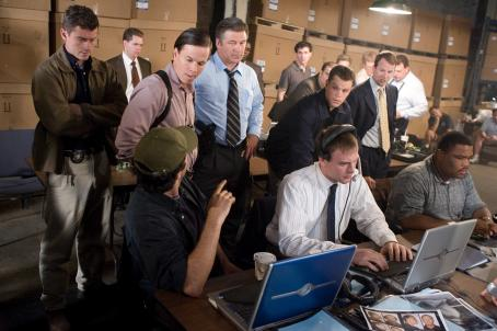 Anthony Anderson Center from left to right: Sergeant Dignam (MARK WAHLBERG), Captain Ellerby (ALEC BALDWIN) and Colin Sullivan (MATT DAMON) head up the surveillance team, including Brown (ANTHONY ANDERSON, seated far right), that is monitoring a meeting between Costello&#