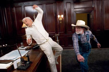 Uncle Jesse Duke BURT REYNOLDS as Boss Hogg gets it from WILLIE NELSON as Uncle Jesse in Warner Bros. Pictures' and Village Roadshow Pictures' action comedy 'The Dukes of Hazzard,' starring Johnny Knoxville, Seann William Scott and Jessica Simpson and dist