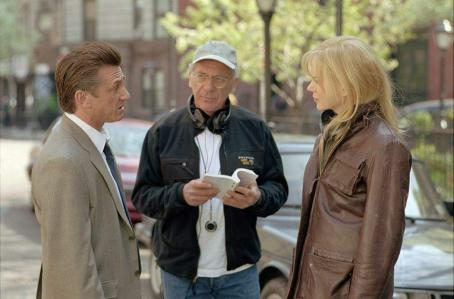 Sydney Pollack (L to r) Sean Penn (federal agent Tobin Keller), director/executive producer , and Nicole Kidman (U.N. interpreter Silvia Broome) on the set of The Interpreter
