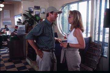Cary Elwes Helen Hunt and  face off in a scene from Twister.