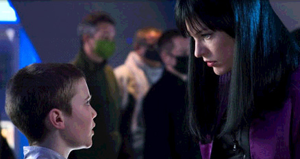 Cameron Bright  as Six and Milla Jovovich as Violet in Action movie Ultraviolet 2006.
