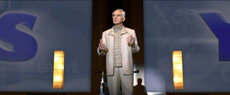 Terence Stamp Terrence (TERENCE STAMP) greets the participants at the Yes seminar in Warner Bros. Pictures' and Village Roadshow's comedy 'Yes Man.' The film stars Jim Carrey and is distributed by Warner Bros. Pictures. Photo courtesy of Warner Bros. Pi