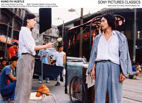 Stephen Chow Left: Huang Sheng Yi as Fong; Right: Filmmaker  as Sing.