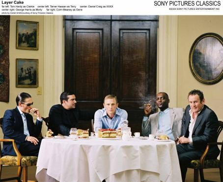 Tom Hardy Far Left:  as Clarkie; Center Left: Tamer Hassan as Terry; Center: Daniel Craig as XXXX; Center Right: George Harris as Morty; Far Right: Colm Meaney as Gene.