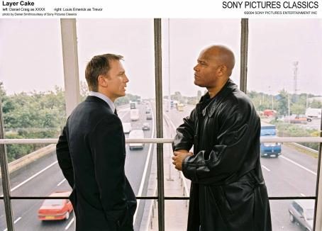 XXXX Left: Daniel Craig as ; Right: Louis Emerick as Trevor.