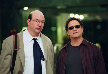 Albert Brooks John Carroll Lynch as Stuart and  as himself in Brooks' Looking for Comedy in the Muslim World, a Warner Independent Pictures release. Photo credit: Lacey Terrell © 2005 Shangri-La Entertainment, LLC.