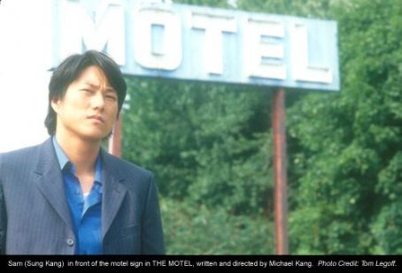The Motel Sam (Sung Kang) in front of the motel sign in , written and directed by Michael Kang. Photo Credit: Tom Legoff.