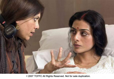 Tabu From left: Director Mira Nair and  on the set of THE NAMESAKE. Photo Credit: Abbot Genser
