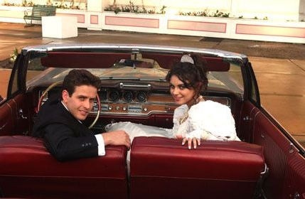 Tony 'n' Tina's Wedding Joey McIntyre as Tony and Mila Kunis as Tina in the scene of Tony 'n' Tina's Wedding.