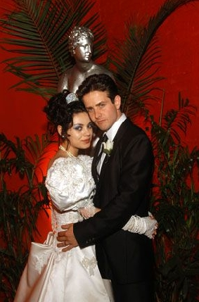 Tony 'n' Tina's Wedding Mila Kunis as Tina and Joey McIntyre as Tony in Tony 'n' Tina's Wedding.