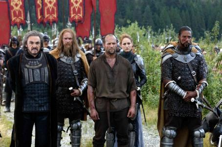 John Rhys-Davies  as Merick, Jason Statham as Farmer, Leelee Sobieski as Muriella and Brian J. White as Tarish in the scene of 'In the Name of the King: A Dungeon Siege Tale.'