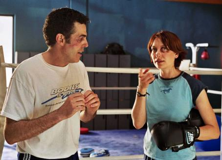 Adam Carolla  as Jerry Ferro and Heather Juergensen as Lindsay Pratt in The Hammer.