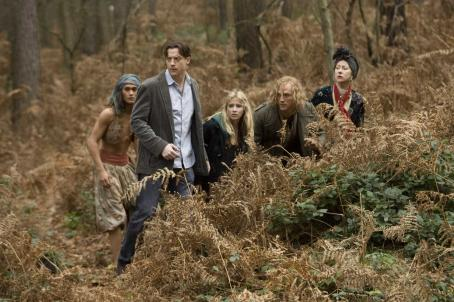 Rafi Gavron (L-R) Farid (RAFI GAVRON), Mo (BRENDAN FRASER), Meggie (ELIZA HOPE BENNETT), Dustfinger (PAUL BETTANY) and Elinor (HELEN MIRREN) hide out from the Black Jackets in New Line Cinema's fantasy adventure 'Inkheart,' also starring JIM BROADBENT and