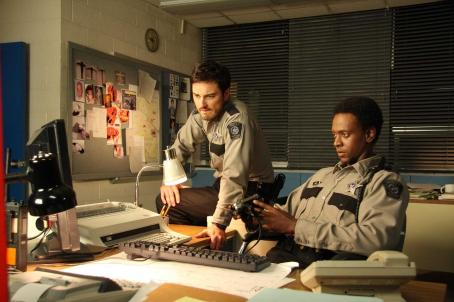 Kerr Smith Axel Palmer (, left) and Deputy Martin (Edi Gathegi) in MY BLOODY VALENTINE 3D. Photo credit: Michael Roberts
