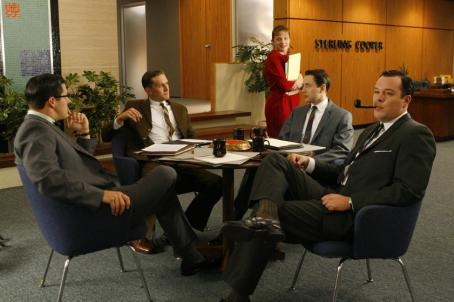 Mad Men L-R: Rich Sommer ('Harry Crane'), Aaron Staton ('Ken Cosgrove'), Vincent Kartheiser ('Pete Campbell'), Elisabeth Moss ('Peggy Olson') and Michael Gladis ('Paul Kinsey') star in Lionsgate Home Entertainment's Mad