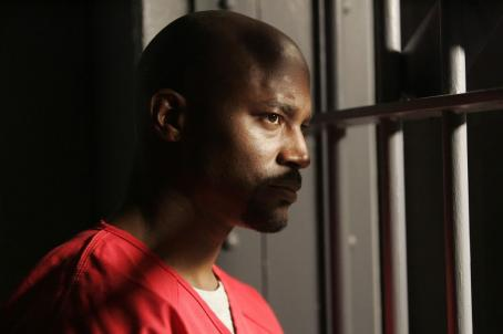 Day Break Taye Diggs as Brett Hopper behind bars
