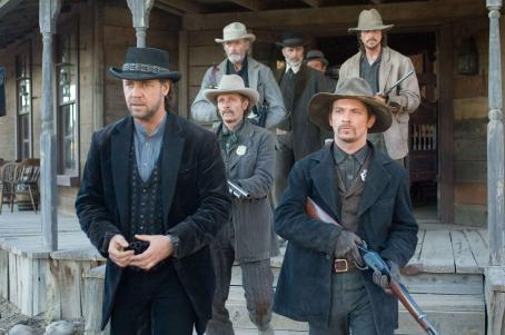 Peter Fonda Ben Wade (Russell Crowe, front left), Kane (Chad Brummett, front right), Marshal Weathers (Luce Rains, middle left), Bryon McElroy (, back left), Dan Evans (Christian Bale, back right), and Glen Hollander (Lennie Loftin, back center) in 3:10 TO