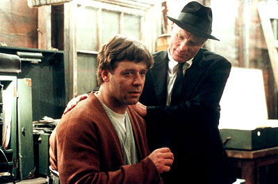 A Beautiful Mind Russell Crowe as John Forbes Nash Jr. and Ed Harris as William Parcher in Universal's  - 2001