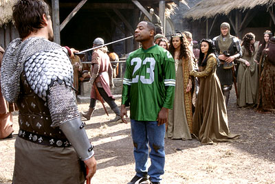 Black Knight Martin Lawrence as Jamal, a fast-talking con-man who finds himself at swordpoint of the evil knight Percival (Vincent Regan) as Victoria (Marsha Thomason) watches in 20th Century Fox's  - 2001