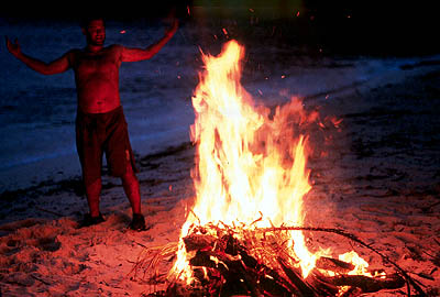 Cast Away Chuck (Tom Hanks) exults in the fire he has learned to create in 20th Century Fox's  - 2000
