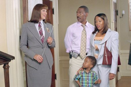Regina King (L to R) Anjelica Huston plays the headmistress of the Chapman Academy at which Charlie (Eddie Murphy) and Kim () hope to enroll their son Ben (Khamani Griffin)
