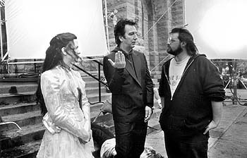 God Alanis Morissette, Alan Rickman and writer/director Kevin Smith on the set of Lions Gate's Dogma - 11/99