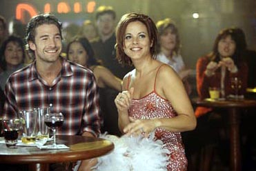 Duets Searching for the meaning of life, down-on-his-luck cab driver Billy Hannon (Scott Speedman, left) finds an unlikely friend in wannabe singing star Suzi Loomis (Maria Bello, right) in Hollywood Pictures'  - 2000