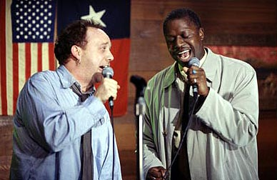 Duets Escaping his mind-numbing existence on the hamster-wheel of life, Todd Woods (Paul Giamatti, left) discovers the joys of karaoke singing and finds a new friend in ex-con and soulful singer Reggie Kane (Andre Braugher, right) in Hollywood Pictures' Due