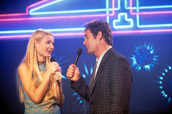 Duets Gwyneth Paltrow (left) stars as an innocent Vegas showgirl who discovers a remarkable connection to a seasoned karaoke hustler (Huey Lewis, right) in the funny, raucous world of the karaoke bars and chain hotels that link the interstates of Middle America