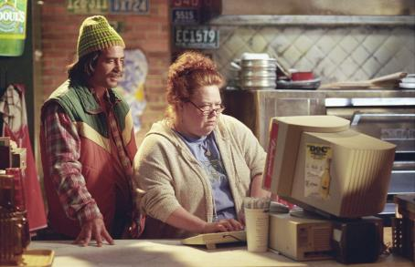 Mr. Deeds Jan (Conchata Ferrell) and Murph (Peter Dante) are Deeds trusty employees in Columbia's  - 2002
