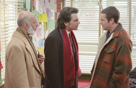 Mr. Deeds Cedar (Peter Gallagher, center) and his crony, Anderson, (Erick Avari, left) tell Longfellow Deeds (Adam Sandler) he's rich in Columbia's  - 2002