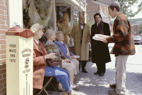 Mr. Deeds Longfellow Deeds (Adam Sandler, right) delivers pizza as Cedar (Peter Gallagher, center right) and his crony, Anderson (Erick Avari, center left) look on in Columbia's  - 2002