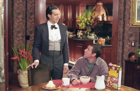 Mr. Deeds Longfellow Deeds (Adam Sandler, right) confides in his trusty valet, Emilio (John Turturro) in Columbia's  - 2002