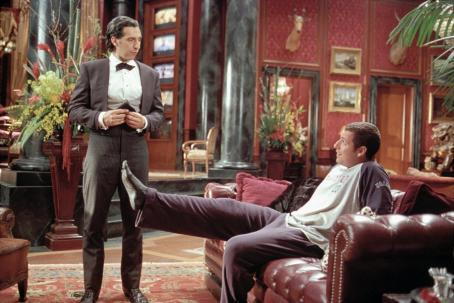 John Turturro Longfellow Deeds (Adam Sandler, right) jokes with his trusty valet, Emilio () in Columbia's Mr. Deeds - 2002