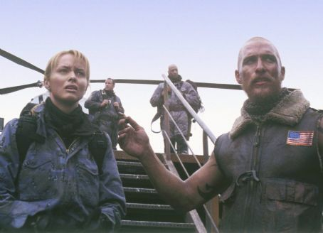 Reign of Fire In foreground (L-R), Alex Jensen (Izabella Scorupco),Van Zan (Matthew McConaughey); in background (L-R) Alvarez (Alex Meacock), Jefferson (David Garrick), Gideon (Terence Maynard) in Touchstone's  - 2002